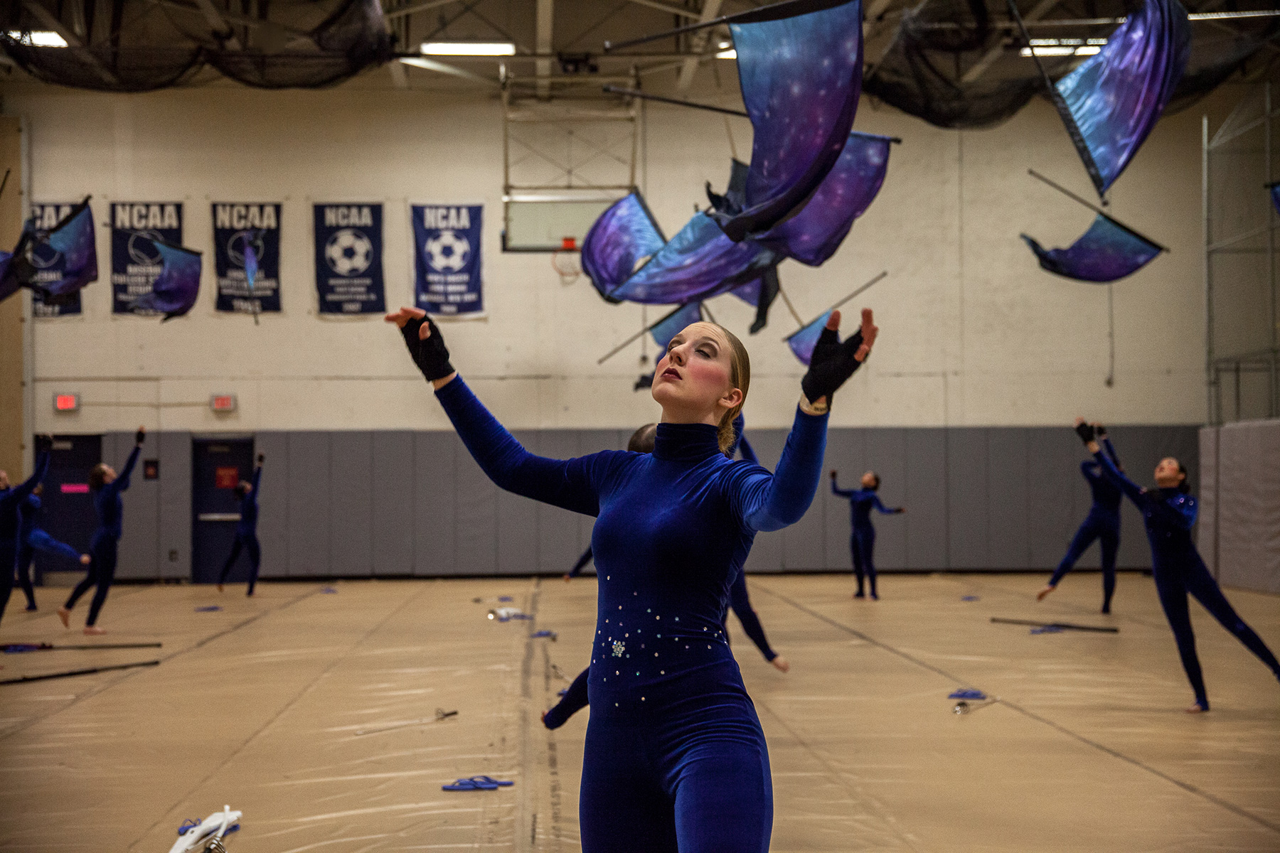 Articles about color guard - Morgan Mcpartland Waits For Her Flag To Descend After Throwing It As The Team Warms Up For Their First Performance At Regionals Click To Enlarge Images